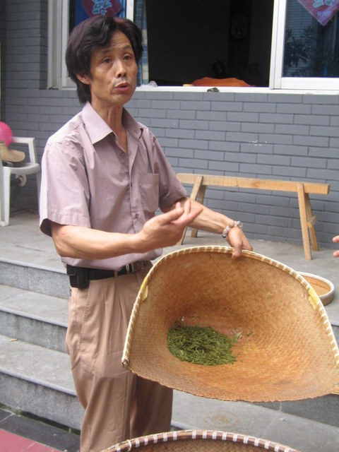 The tea master explaining the drying process